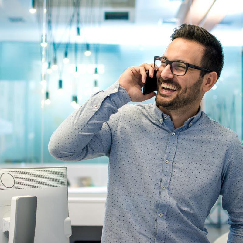 man-smiling-on-phone